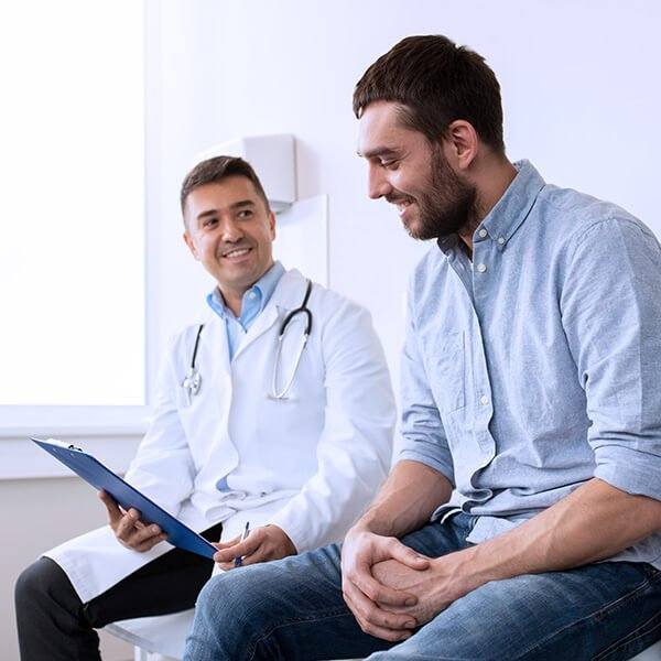 happy doctor and patient discussing positive results