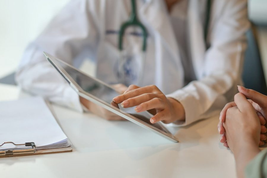 patient being shown results by doctor on a tablet